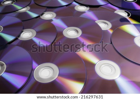 Background of some colorful compact discs - stock photo