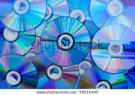 Background of some colorful compact discs. - stock photo