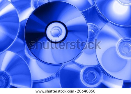 Background of some compact discs - blue toning. - stock photo