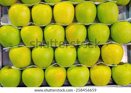 Background of some green apples for sale at a market - stock photo