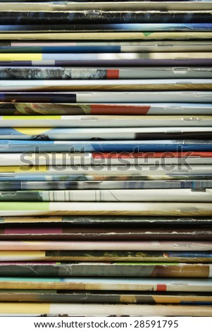 Background of stacked magazines in different colors
