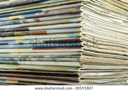 Background of stacked magazines in different colors - stock photo