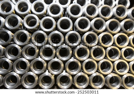 Background of steel tubes. - stock photo