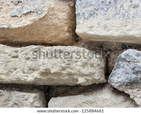 Background of stone wall texture. Closeup.
