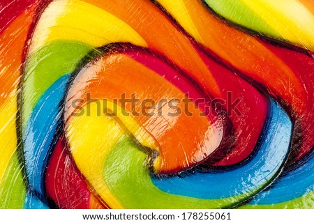 Background of striped spiral multicolored candy close up  - stock photo
