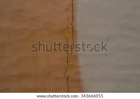 background of Textured cracked pink and gray color wall. Abstract concrete, weathered with cracks and scratches. Landscape style. Grungy  Surface. Great backdrop or texture. - stock photo