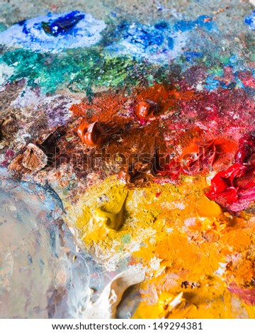 background of the artist's oil paints on a palette - stock photo