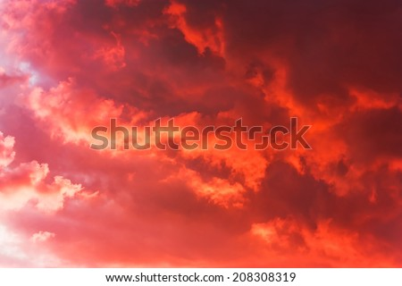 Background of the blood red evening sky and clouds - stock photo