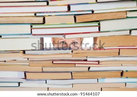 Background of the books and look through the hole girl. - stock photo