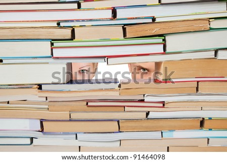 Background of the books and people look through the hole. - stock photo