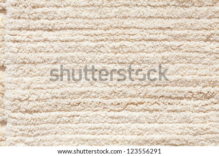 background of the carpet from the sheep wool at the fair - stock photo