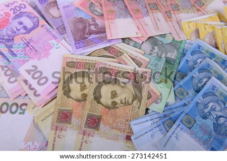 Background of the different denomination currency Ukrainian hryvnia - stock photo