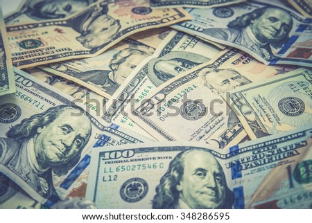 Background of the dollar banknotes, money. toned photo