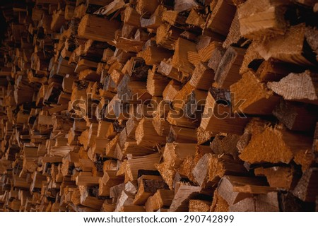 Background of the dry chopped firewood logs in a pile - stock photo