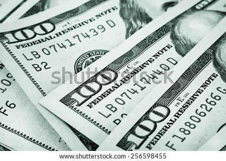 Background of the folded fan of hundred-dollar bills stained in green tone - stock photo