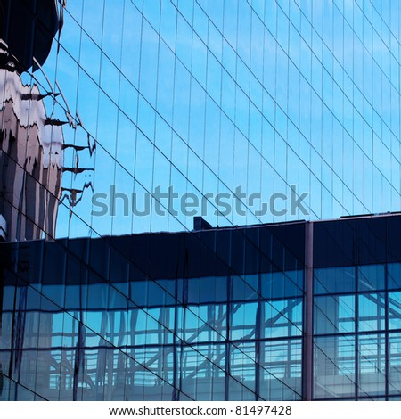 background of the glass modern office building - stock photo