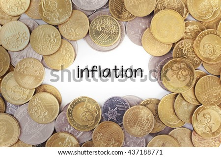 Background of the gold coin with word inflation in the middle - stock photo