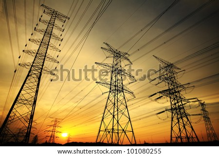 Background of the high-voltage tower in the sunset in skyline - stock photo