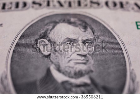 background of the money, five dollar bills front side. background of dollars, close up, President Abraham Lincoln on the five dollar bill series 1995