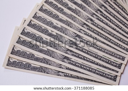 background of the money, hundred dollar bills front side. background of dollars, old hundred-dollar bil face, fan from american dollars banknotes. Isolate on white.