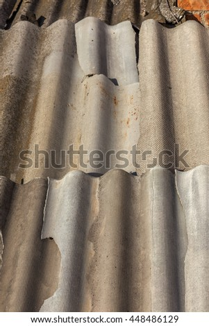 Background of the old slate roof coverings. Old tile sheet flows and requires urgent repairs - stock photo