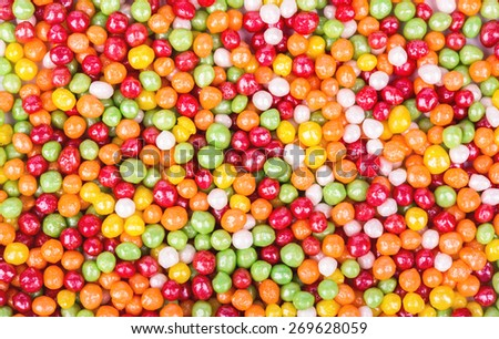Background of the plurality scattered multicolored round sweets - stock photo