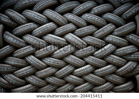 Background of the wall of tires laid at an angle - stock photo