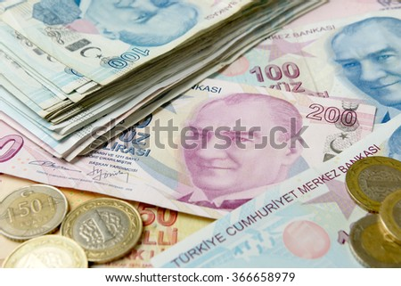 Background of Turkish Lira banknotes and coins. - stock photo