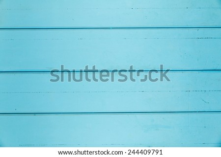 Background of turquoise wood paneling with some dings - stock photo