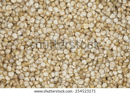 Background of uncooked quinoa.  Macro image with selective focus. - stock photo