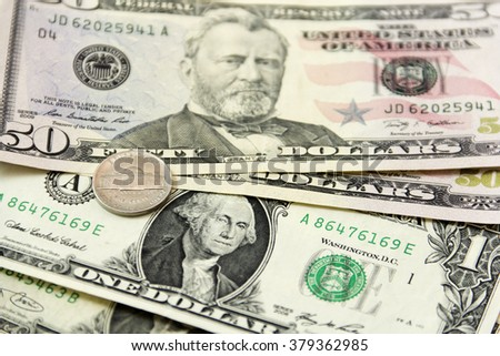 Background of US dollars and coins.