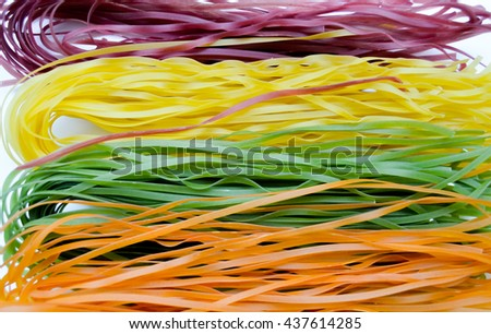 Background Of Varicolored Raw Italian Pasta With Natural Vegetable Dye  (spinach, Paprika, Beet