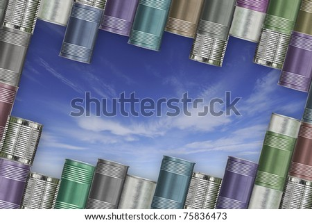 background of variety cans and blue sky, used as a framework. - stock photo