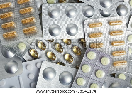 background of various blister packs with pills and capsules - stock photo
