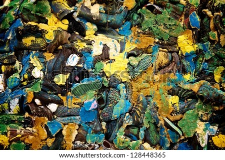 Background of various shoes glued to one pile - stock photo