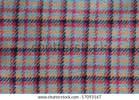 background of vintage wool multicolored plaid fabric