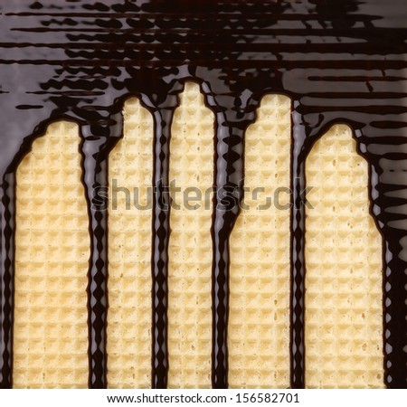 Background of wafer. Stream chocolate. Close up. - stock photo