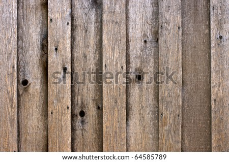 Background of weathered upright boards - stock photo