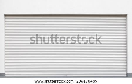 background of white grunge metallic roller shutter door  - stock photo