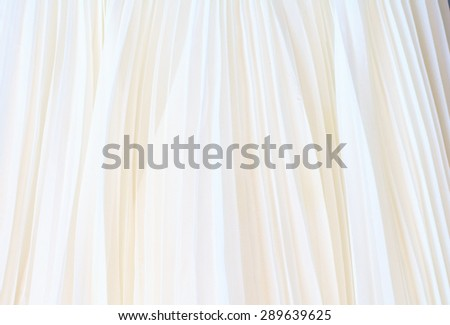 Background of white pleated fabric - stock photo