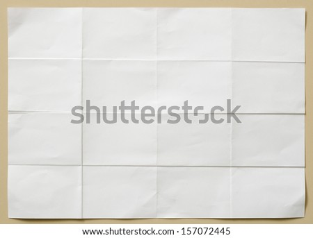 background of white textured sheet of paper folded in sixteen  part for write - stock photo
