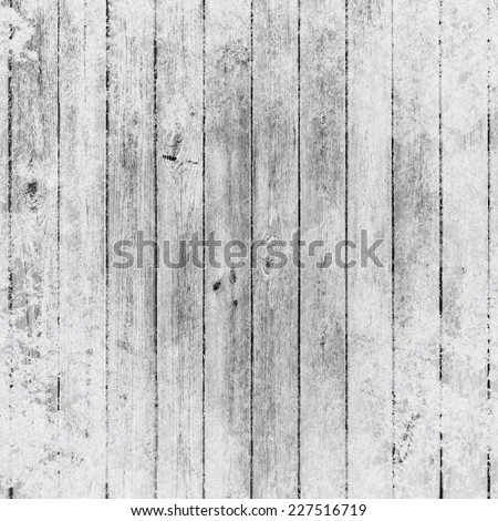 Background of wooden boards in snow - stock photo