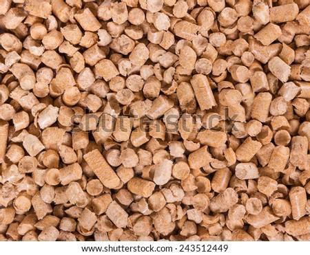 Background of wooden filler for cat litter - stock photo