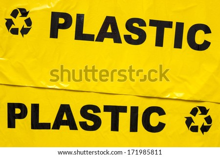 Background of yellow garbage bags for recyclable plastic - stock photo