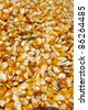 Background of yellow maize corn kernels ready for making popcorn - stock photo
