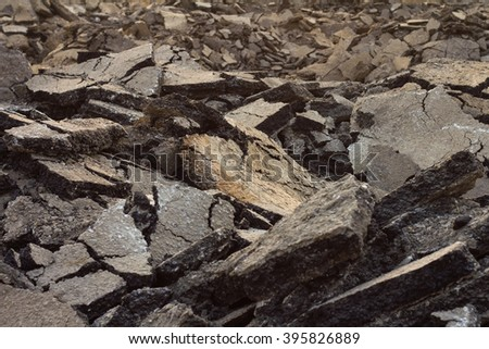 Background old cracked asphalt road scrap heap damage on the ground to be recycled. - stock photo