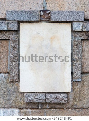 Background old stone wall with a blank slab for any inscriptions or bas creative design - stock photo
