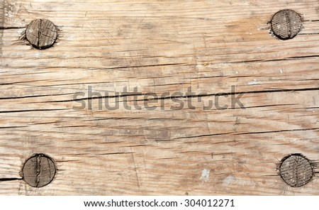 Background. Old, vintage, gray plywood with wooden rivets - stock photo