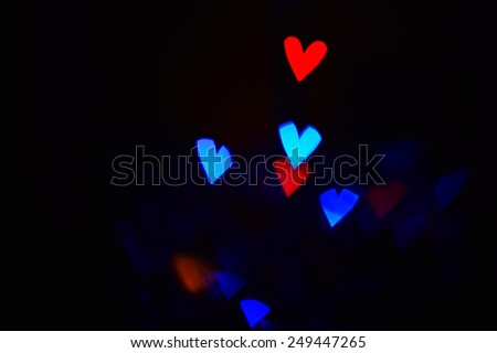 Background on Valentine's Day Black background with colored hearts for lovers - stock photo