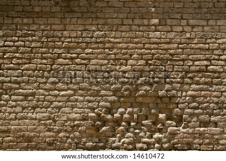 background or pattern of a broken brick stone wall, historic european church - stock photo